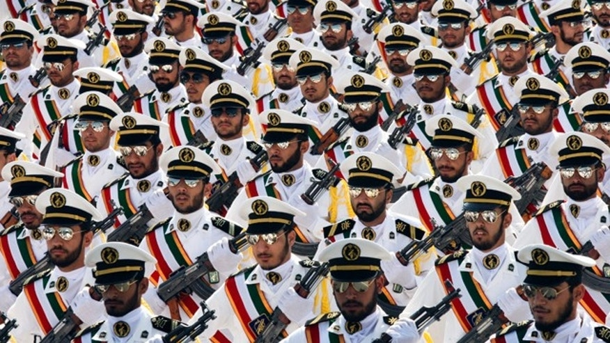 FILE: In this Sep. 22, 2011, photo, members of the Iranian Revolutionary Guard Navy march during a parade to commemorate the anniversary of the Iran-Iraq war in Tehran.