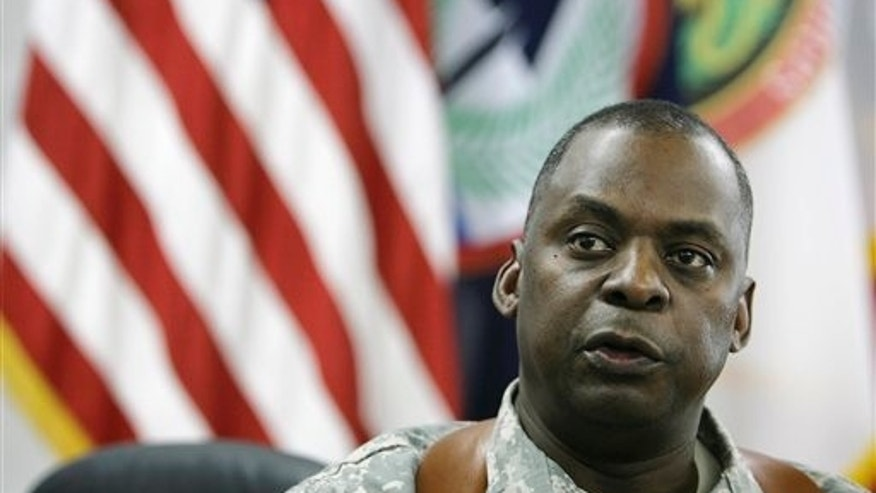 "In a Thursday, May 22, 2008 file photo, Gen. Lloyd Austin talks during an interview to the Associated Press in Baghdad, Iraq. The top American general in Iraq said Monday Nov. 21, 2011 the country will face some ""turbulence"" after American forces leave."