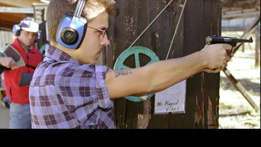 Man performs target practice at a shooting range