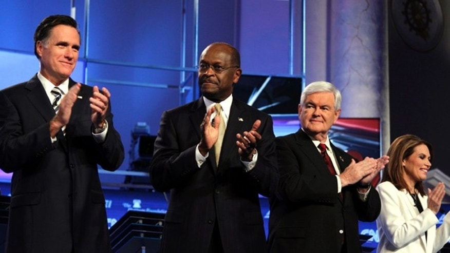 Nov. 22, 2011: Republican presidential candidates from left, former Massachusetts Gov. Mitt Romney, businessman Herman Cain, former House Speaker Newt Gingrich, and Rep. Michele Bachmann, R-Minn., applaud on stage before a Republican presidential debate in Washington.