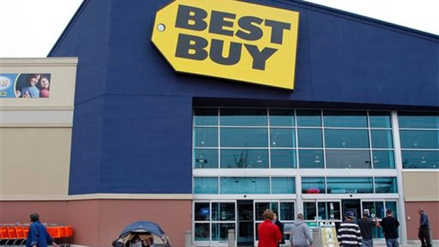 Nov. 21, 2011: Shoppers walk into a Best Buy in Mesquite, Texas, while one family hangs out by their tent, set up so they can be the first in line for Black Friday.