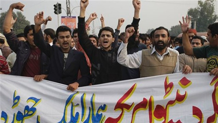 Nov. 26, 2011: Pakistani protesters shout slogans against America and NATO in Lahore, Pakistan.