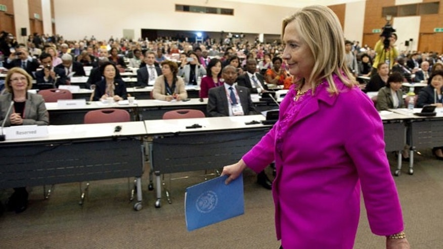 Nov. 30, 2011: Secretary of State Hillary Rodham Clinton leaves after speaking during a Special Session on Gender at the Fourth High Level Forum on Aid Effectiveness in Busan, South Korea.