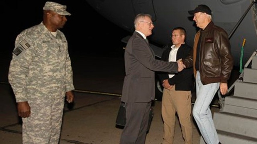 November 29, 2011: Gen. Lloyd Austin, the top U.S. commander in Iraq, right, looks on as U.S. Vice President Joe Biden, left, shake hands with the U.S. Ambassador to Iraq James Jeffrey after he arrived, in Baghdad, Iraq.