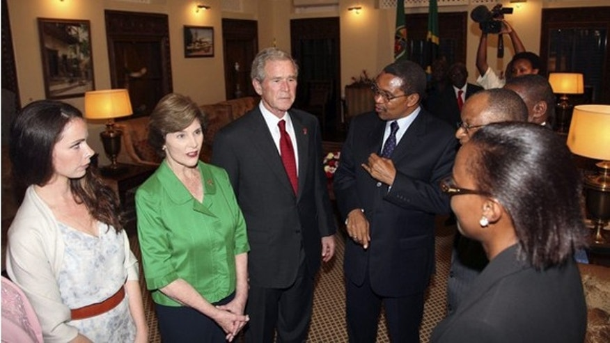 Dec. 1, 2011: Former President George W. Bush speaks with Tanzanian President Jakaya Kikwete upon arriving at the State House in Dar es Salaam.