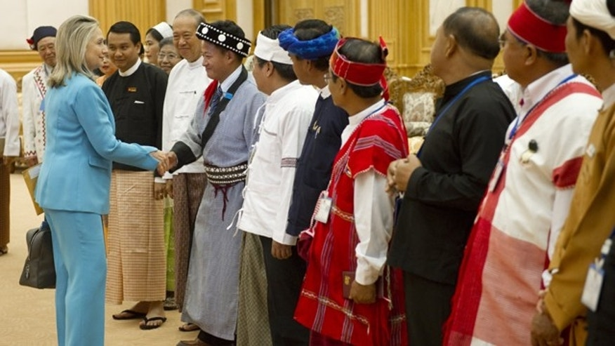 Dec. 1, 2011: Secretary of State Hillary Clinton greets membrs of the Upper House of Parliament in Naypyitaw, Burma.