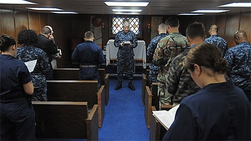Jan. 30: Capt. Stephen Pike, chaplain of Commander, U.S. Naval Forces Europe-Africa/U.S. 6th Fleet, leads Sailors and embarked staff in prayer aboard the amphibious command ship USS Mount Whitney.