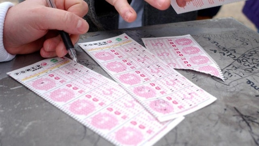 Customers are shown here picking numbers on Powerball lottery forms.