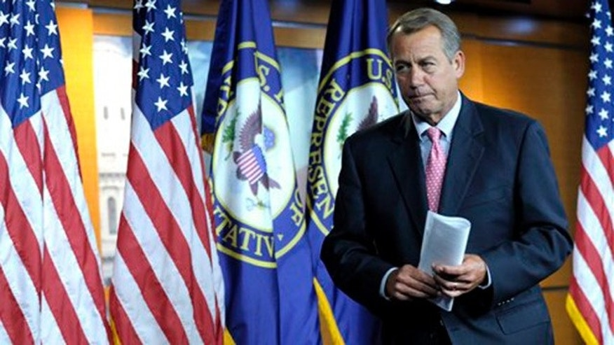 Dec. 1, 2011: House Speaker John Boehner leaves his news conference on Capitol Hill.