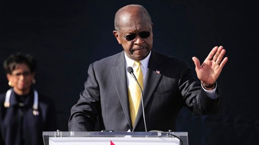 Dec. 3, 2011: Herman Cain announces he is suspending his campaign as his wife Gloria, left, looks on in Atlanta.
