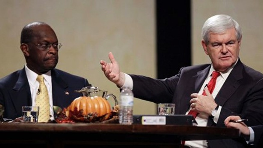November 19, 2011: Former House Speaker Newt Gingrich speaks during the Thanksgiving Family Forum sponsored by The Family Leader as former CEO of Godfather's Pizza Herman Cain looks on.
