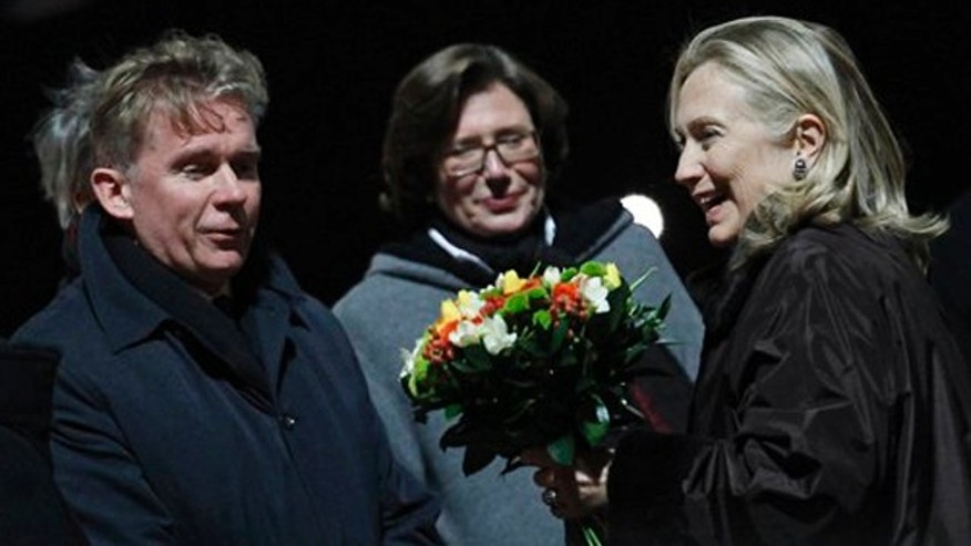 December 6, 2011: U.S. Secretary of State Hillary Rodham Clinton, right, is greeted by Lithuania's  Foreign Minister Audrius Azubalis, left, and US Ambassador Anne E. Derse, center, upon her arrival by her aeroplane  at Vilnius  airport  in Vilnius, Lithuania.