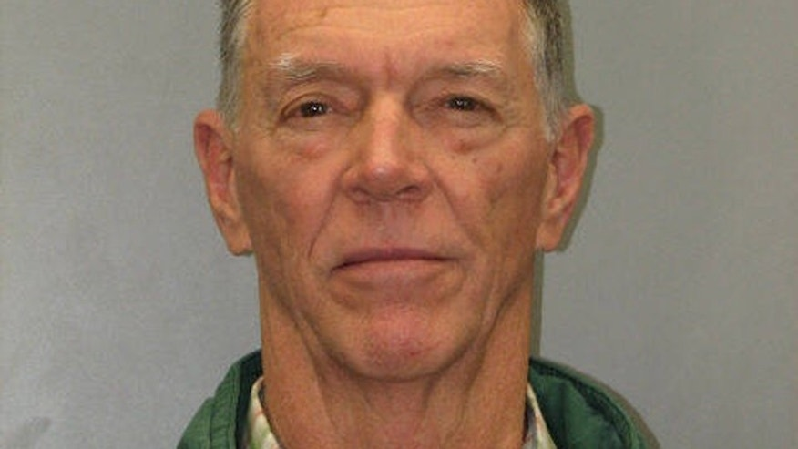 """The booking photo for FAA Administrator Jerome """"Randy"""" Babbitt."""