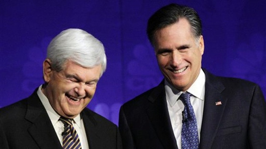 Nov. 9, 2011: Republican presidential candidates former House Speaker Newt Gingrich and former Massachusetts Gov. Mitt Romney laugh before a Republican presidential debate at Oakland University in Auburn Hills, Mich.