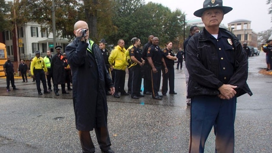 File photo, November 1, 2011. State police prepare to make arrests in protest against Alabama's hardline immigration law. (AP/Dave Martin)