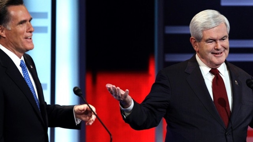 Dec. 10: Mitt Romney, left, and Newt Gingrich, square off in GOP debate.