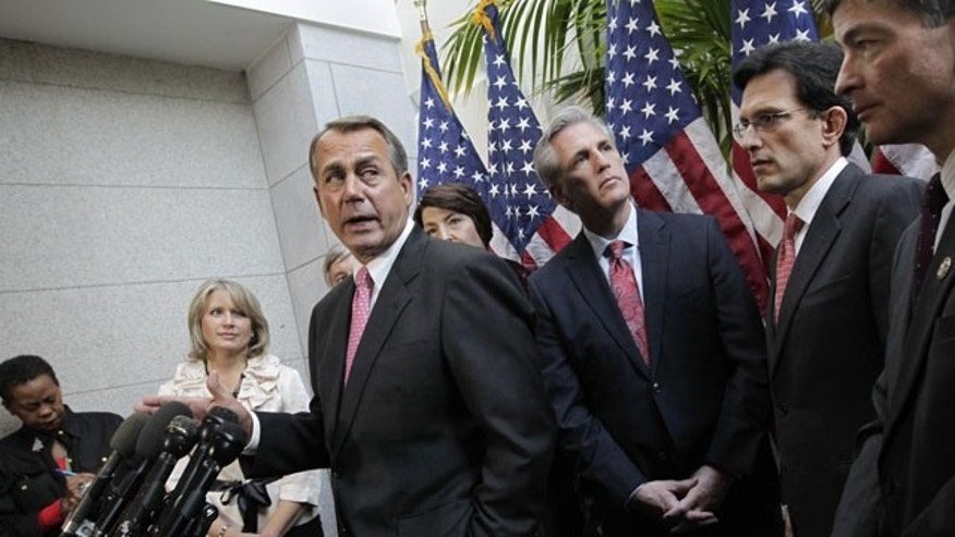 December 13, 2011: House Speaker John Boehner of Ohio, center, accompanied by fellow Republican leaders, meets with reporters on Capitol Hill in Washington.