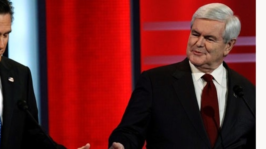 Presidential hopefuls Mitt Romney, left, and Newt Gingrich during the Republican debate on Dec. 10, 2011, in Des Moines, Iowa (AP Photo/Charlie Neibergall)