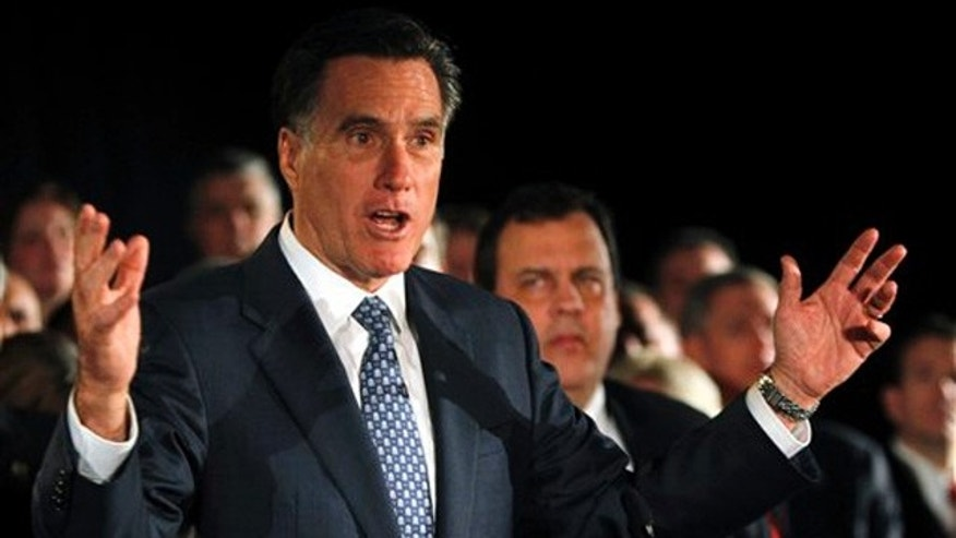 Dec. 12, 2011: Mitt Romney gestures during a speech at a fundraising event in Parsippany, N.J.