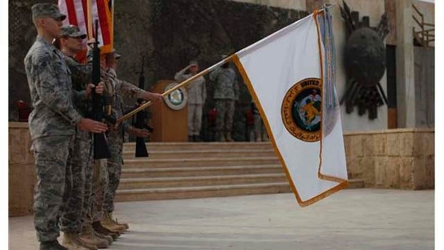 Dec. 15, 2011: The US Forces Iraq colors are lowered before being encased in a ceremony in Baghdad, Iraq, on Thursday. The ceremonies mark the official end of the US military mission in Iraq.