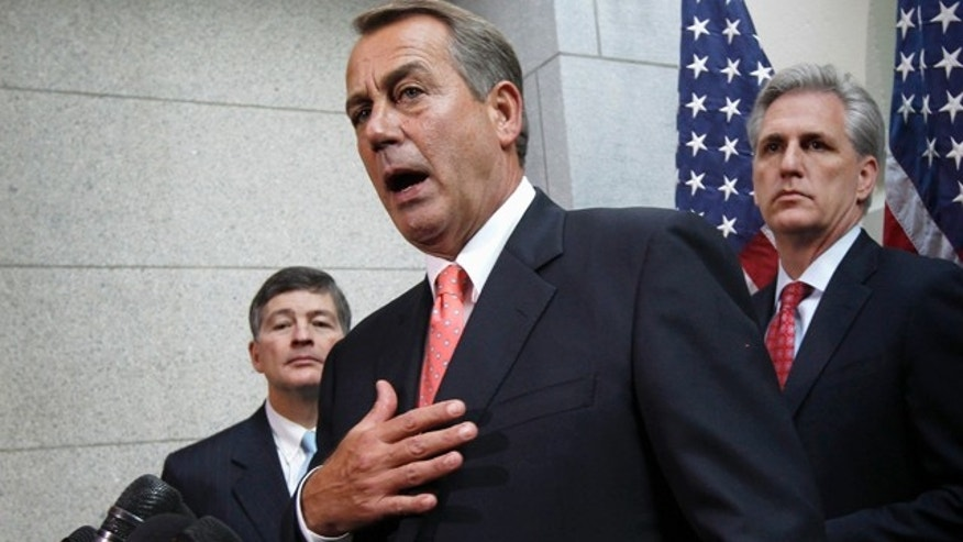 Dec. 16, 2011: House Speaker John Boehner of Ohio, flanked by Rep. Jeb Hensarling, R-Texas, left, and House Majority Whip Kevin McCarthy, R-Calif., briefs reporters on Capitol Hill after  lawmakers from both political parties came together on an 11th-hour deal to keep the government from shutting down.
