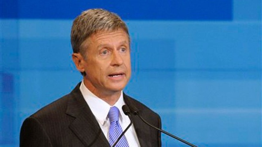 Republican presidential candidate former New Mexico Gov. Gary Johnson makes a statement during a debate Thursday, Sept. 22, 2011, in Orlando, Fla.