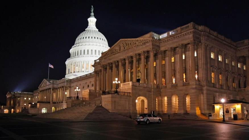 In this April 7, 2011, file photo the U.S. Capitol in Washington is illuminated at night as Congress work late to avert a government shutdown.