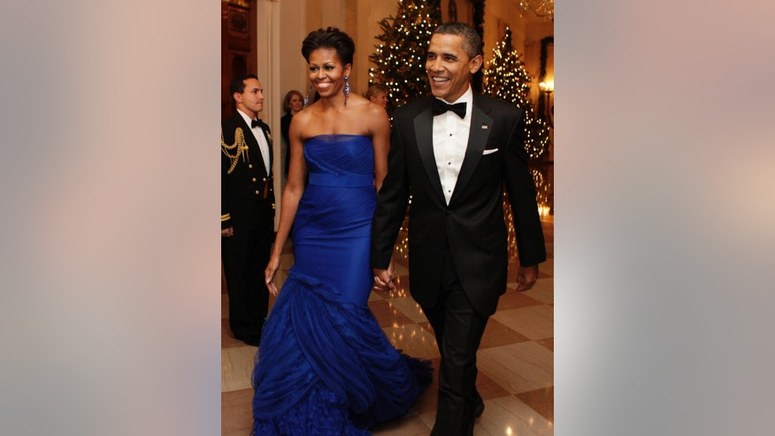 Dec. 14, 2011: U.S. President Barack Obama and first lady Michelle Obama arrive at the Kennedy Center Honors reception at the White House in Washington.