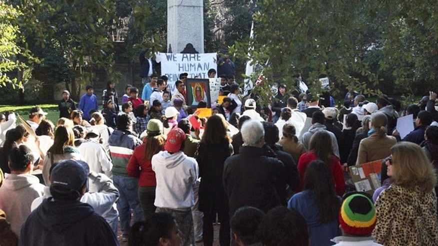 December 19, 2011: Protestors with the South Carolina Immigration Coalition rally in Washington Park Monday morning in Charleston, S.C., against South Carolina law SB 20.