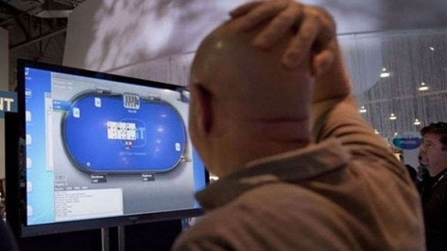 October 4, 2011: Casino industry representatives and exhibitors watch an online poker game during industry's G2E conference in Las Vegas.