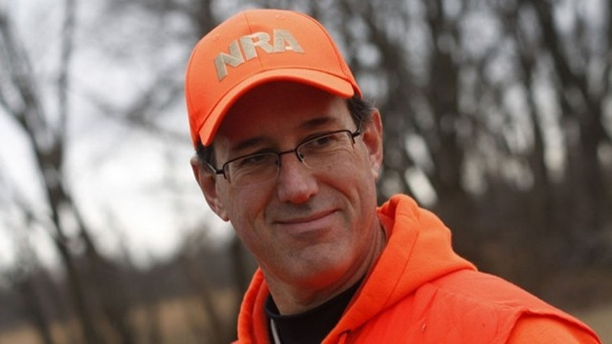 Dec. 26, 2011: Republican presidential candidate and former Pennsylvania Sen. Rick Santorum takes a break from pheasant hunting in Adel, Iowa.