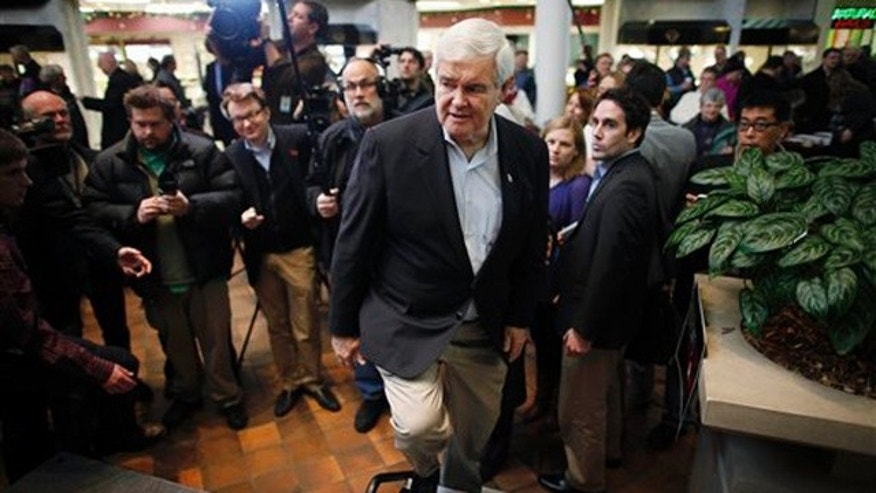 Dec. 28, 2011: Newt Gingrich takes the stage before speaking to reporters at a campaign stop in Mason City, Iowa.
