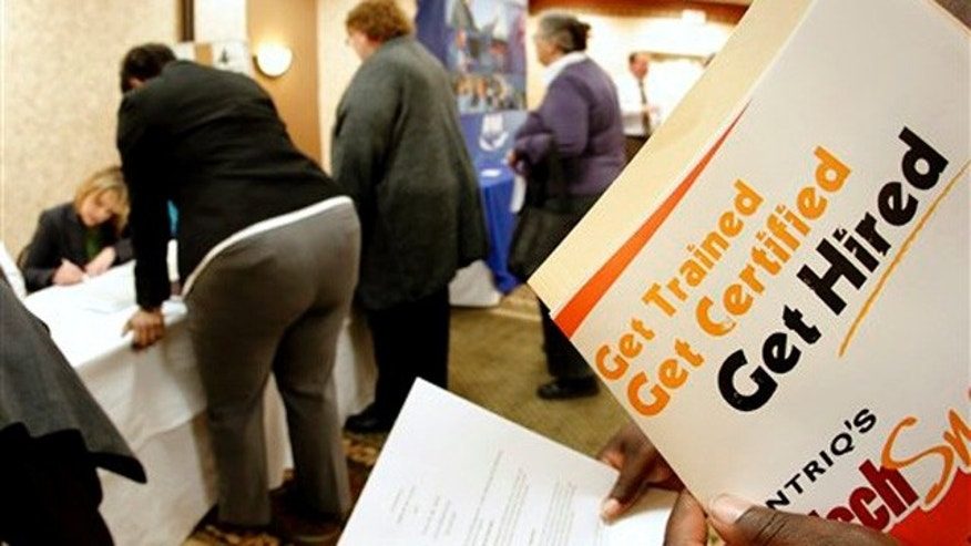 Dec. 1, 2011: Job seekers attend a career fair in Overland Park, Kan.