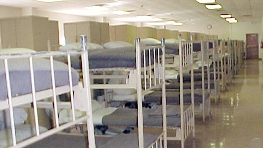 In this undated  handout photo provided by the Bureau of Prisons, beds are lined up in a dormitory of the Bastrop Federal Correctional Institution, a low- and minimum-security prison about 30 miles southeast of Austin in Bastrop, Texas. Former Enron Corp. executive Richard Causey reported to the prison Wednesday, Jan. 3, 2007 to begin serving five- and-a-half years for his role in the company's scandalous collapse.  (AP Photo/Bureau of Prisons)