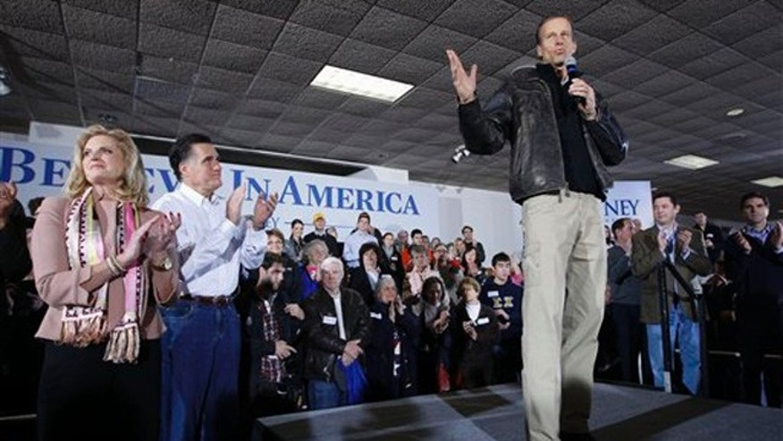 Jan. 2, 2012: Sen. John Thune, right, stumps for Mitt Romney during a campaign event at the Mississippi Valley Fairgrounds in Davenport, Iowa.