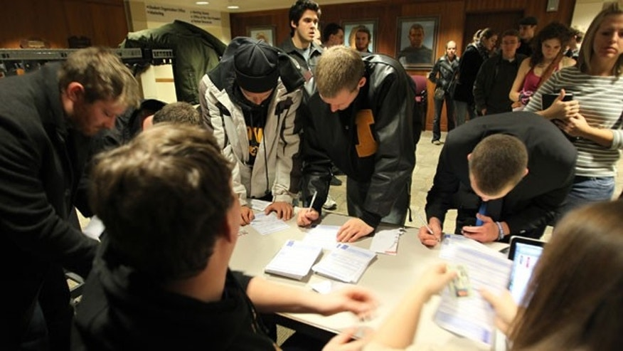 Jan. 3, 2012: Caucus voters fill out the same day voter registration paperwork so they can participate in the Republican presidential caucus at the Iowa Memorial Union on the University of Iowa Campus in Iowa City, Iowa.