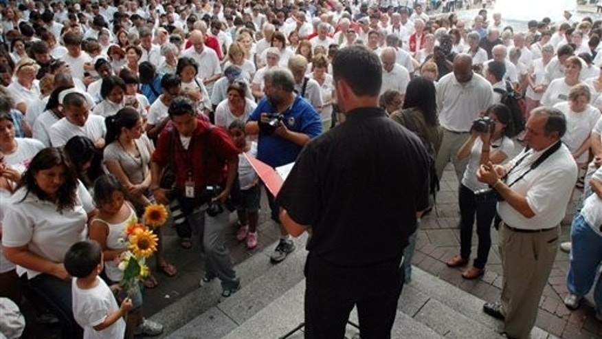 Demonstrators in Alabama bow their heads in prayer during a June demonstration to protest the new state law against illegal immigration. The law is said to be the strictest state-level immigration law in the country.