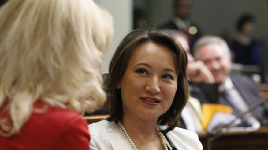 January 4, 2012: Assemblywoman Mary Hayashi, D-Castro Valley, left, talks with her seatmate, Assemblywoman Cathleen Galgiani, D-Livingston, at the Capitol in Sacramento, Calif.