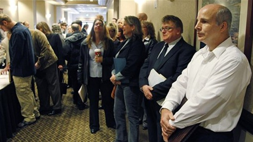 Dec. 2, 2011: People wait in line to enter a job fair in Portland, Ore.