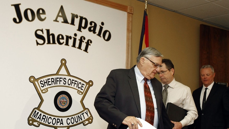 Dec. 5, 2011: Maricopa County Sheriff Joe Arpaio, left, Capt. Steve Whitney, middle, and Chief Deputy Jerry Sheridan, right, arrive for a news conference to discuss the latest in the doc. release on Arpaio's offices' handling of many sexual assault cases over the years in El Mirage, Ariz.