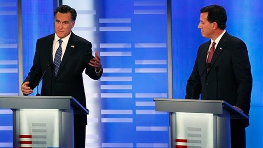 Jan. 7, 2012: Former Massachusetts Gov. Mitt Romney, left, answers a question as former Pennsylvania Sen. Rick Santorum listens during a Republican presidential candidate debate at Saint Anselm College in Manchester, N.H.