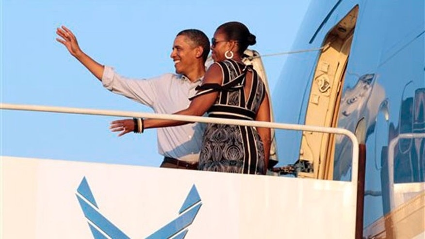 Jan. 2, 2012: President Obama and first lady Michelle Obama board Air Force One at Hickam Air Force Base in Honolulu.