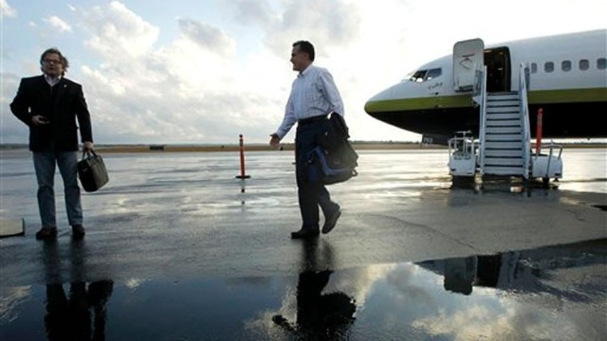 Jan. 11, 2012: Mitt Romney walks towards an adviser as they step off his campaign charter plane in Columbia, S.C.