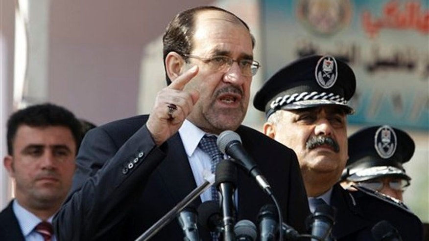 Jan. 9, 2012: Iraqi Prime Minister Nouri al-Maliki, center, speaks at a ceremony marking Police Day at the police academy in Baghdad, Iraq.