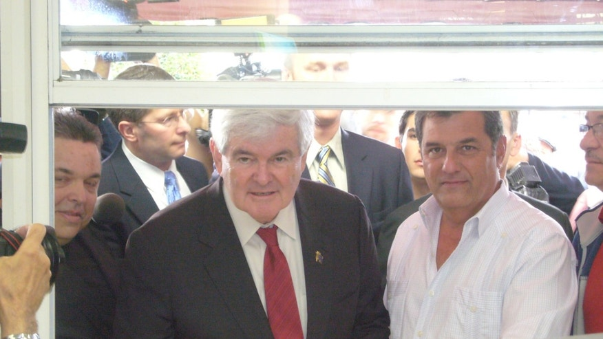 GOP presidential contender Newt Gingrich in South Florida, courting Latino voters -- and sipping Cuban coffee -- at a popular Cuban restaurant.