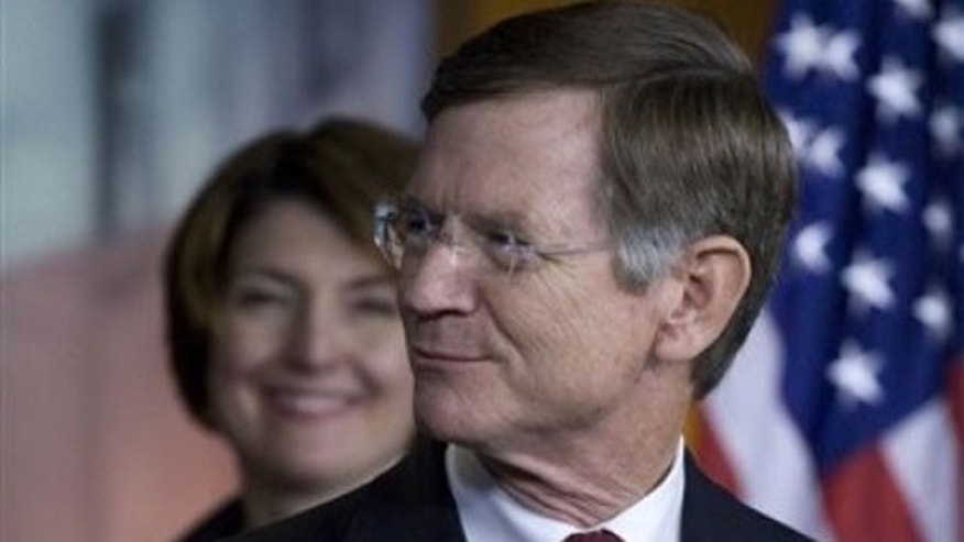 May 26, 2011: Rep. Lamar Smith, R-Texas, right, accompanied by Rep. Cathy McMorris Rodgers, R-Wash. smiles during a news conference on Capitol Hill in Washington.