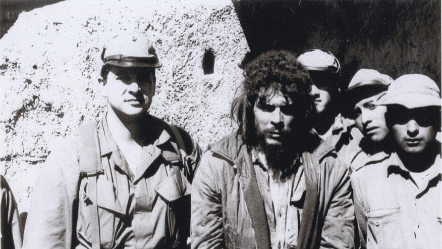 In this 1967 photo provided by Felix Rodriguez, Rodriguez, left, is shown with Che Guevara, center, before Guevara was executed in Bolivia. (AP Photo/Courtesy of Felix Rodriguez)