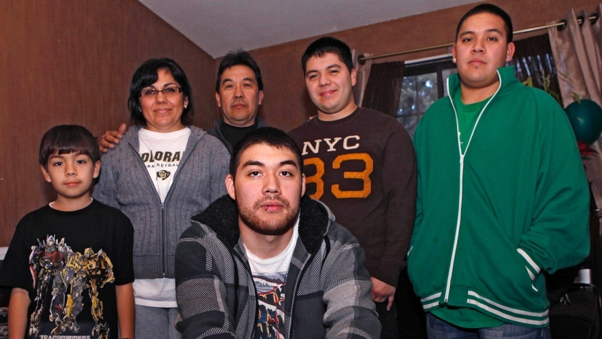 Jesus Gerardo Noriega, front, poses with his parents and brothers at the family home in Aurora, Colo. Jesus, 21, faced deportation last year after he was arrested for driving with no license plate light.