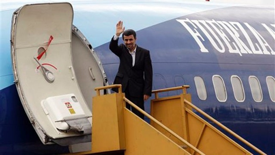 Jan. 13, 2012: Iranian President Mahmoud Ahmadinejad waves to reporters from his airplane at an air base as he departs Quito, Ecuador.