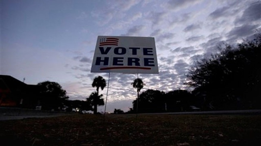 Jan. 21, 2012: The sun rises behind a sign at a polling site in Sullivan's Island, S.C.